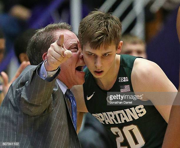 Head coach Tom Izzo of the Michigan State Spartans gets into the ear of Matt McQuaid during a game against the Northwestern Wildcats at WelshRyan...
