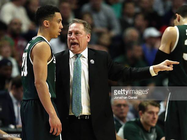 Head coach Tom Izzo of the Michigan State Spartans gives instructions to Travis Trice as they take on the Wisconsin Badgers during the Championship...