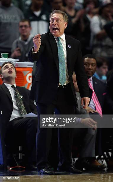 Head coach Tom Izzo of the Michigan State Spartans gives instructions to his team against the Wisconsin Badgers during the Championship game of the...