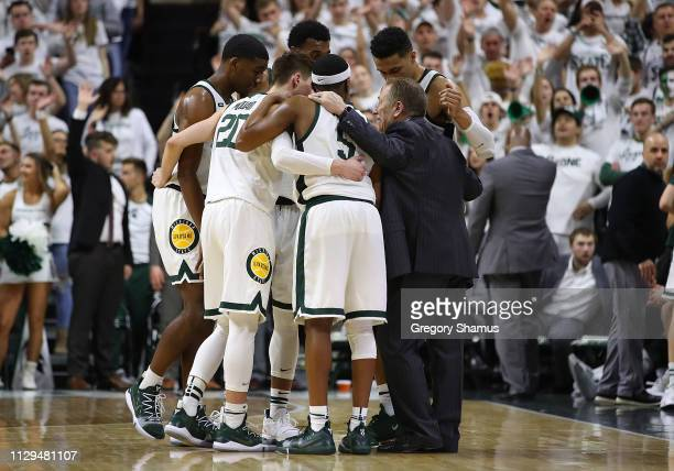 Head coach Tom Izzo of the Michigan State Spartans huddles with his team during the second half against the Michigan Wolverines at Breslin Center on...