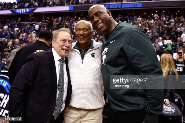 Head coach Tom Izzo of the Michigan State Spartans Joel Ferguson and Magic Johnson pose for photos following the game against the Duke Blue Devils...