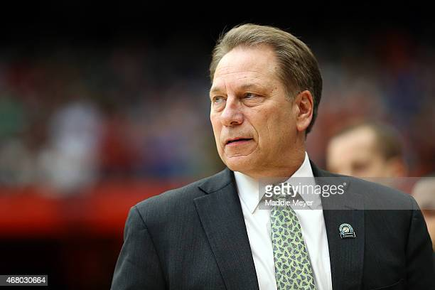 Head coach Tom Izzo of the Michigan State Spartans looks pn prior to the start of the first half of the game against the Louisville Cardinals during...