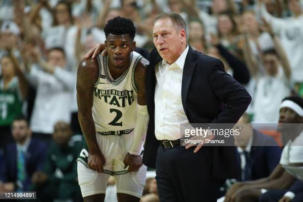 Head coach Tom Izzo of the Michigan State Spartans talks to Rocket Watts while playing the Ohio State Buckeyes at the Breslin Center on March 08,...