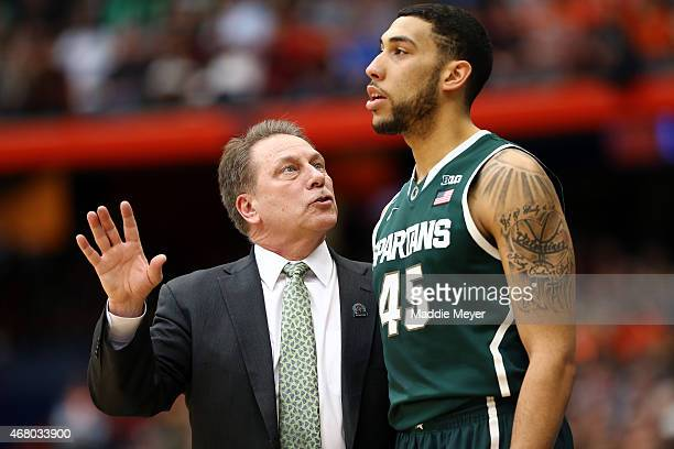 Head coach Tom Izzo of the Michigan State Spartans talks with Denzel Valentine in the first half of the game against the Louisville Cardinals during...