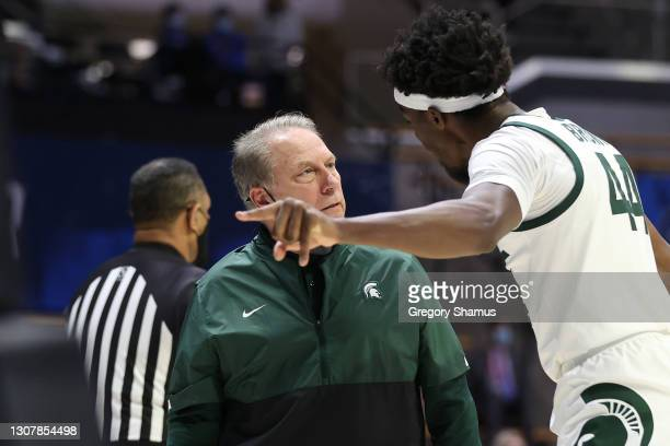 Head coach Tom Izzo of the Michigan State Spartans talks with Gabe Brown of the Michigan State Spartans against the UCLA Bruins during the first half...