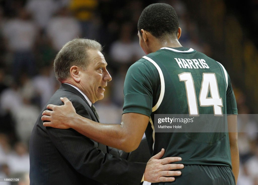 Head coach Tom Izzo of the Michigan State Spartans talks with guard Gary Harris #14 during a timeout in the second half against the Iowa Hawkeyes on January 10, 2013 at Carver-Hawkeye Arena in Iowa City, Iowa. Michigan State won 62-59.