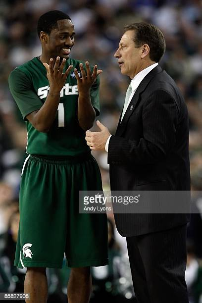 Head coach Tom Izzo of the Michigan State Spartans talks with Kalin Lucas against the Connecticut Huskies during the National Semifinal game of the...