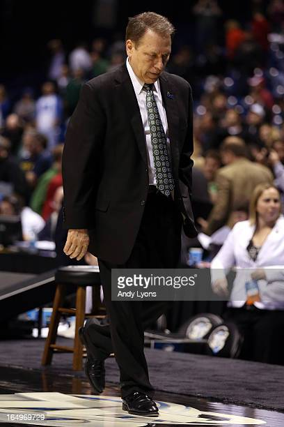 Head coach Tom Izzo of the Michigan State Spartans walks off of the court dejeced with his head down after they lost 7161 against the Duke Blue...
