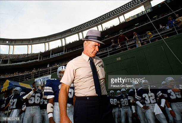 Head coach Tom Landry of the Dallas Cowboys stands with his team before coming onto the field before an NFL football game circa 1978 Landry coached...