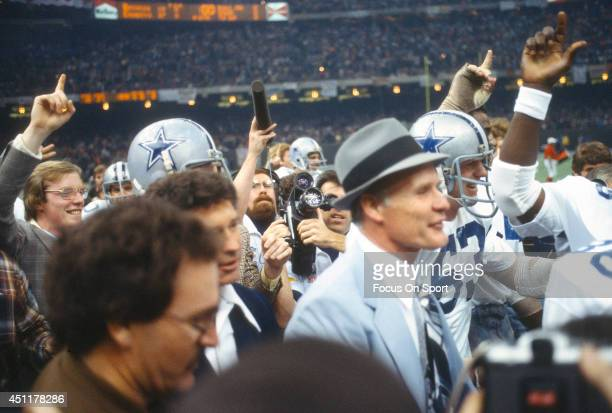 Head Coach Tom Landry of the Dallas Cowboys start to walk off the field with his players after they defeated the Denver Broncos in Super Bowl XII on...