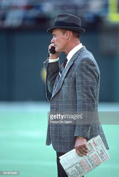 Head coach Tom Landry of the Dallas Cowboys talks with his coaches on the phone during an NFL football game circa 1980 Landry coached the Cowboys...