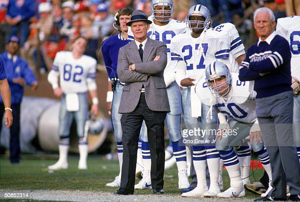 Head coach Tom Landry of the Dallas Cowboys watches from the sideline during a game in the 1988 season Tom Landry coached the Cowboys from 1960 to...