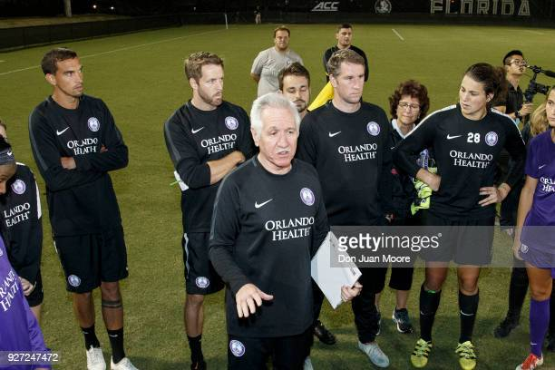 Head Coach Tom Sermanni of the Orlando Pride talk with players after their preseason match against the Florida State Seminoles at the Seminole Soccer...