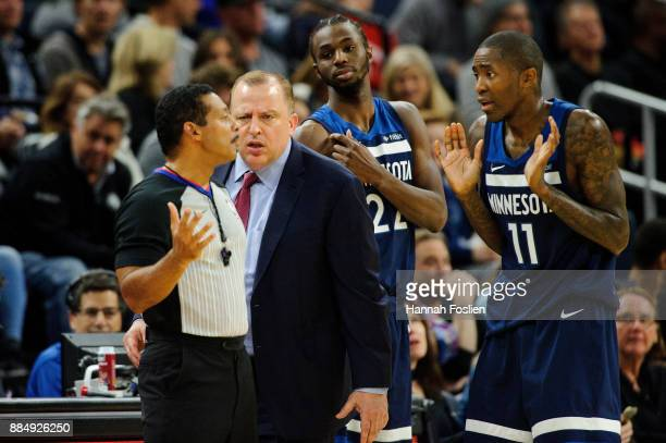 Head coach Tom Thibodeau of the Minnesota Timberwolves speaks to referee Bill Kennedy as Andrew Wiggins and Jamal Crawford reacts during the game...