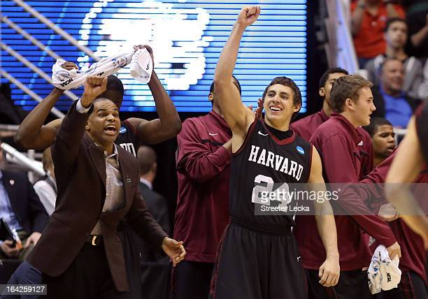 Head coach Tommy Amaker of the Harvard Crimson and Jonah Travis react in the second half while taking on the New Mexico Lobos during the second round...