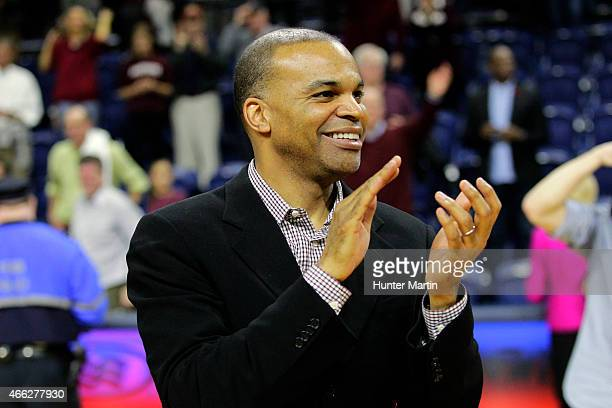 Head coach Tommy Amaker of the Harvard Crimson claps for his team after winning a game against the Yale Bulldogs at the Palestra on the campus of the...