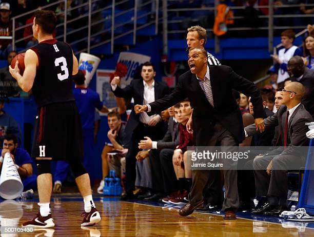 Head coach Tommy Amaker of the Harvard Crimson coaches from the bench during the game against the Kansas Jayhawks at Allen Fieldhouse on December 5,...