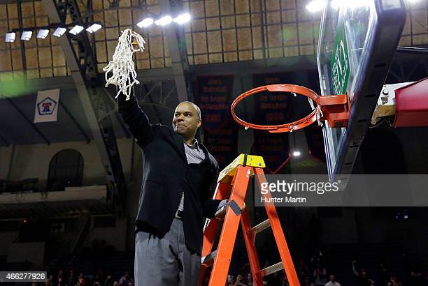 Head coach Tommy Amaker of the Harvard Crimson cuts down the net after winning a game against the Yale Bulldogs at the Palestra on the campus of the...