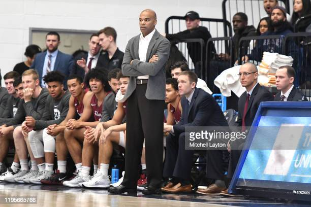 Head coach Tommy Amaker of the Harvard Crimson looks on during a college basketball game against the George Washington Colonials at the Smith Center...