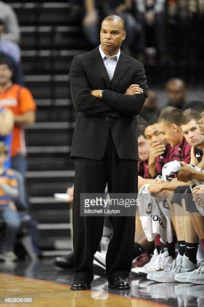 Head coach Tommy Amaker of the Harvard Crimson looks on during a college basketball game against the Virginia Cavaliers at the John Paul Jones Arena...
