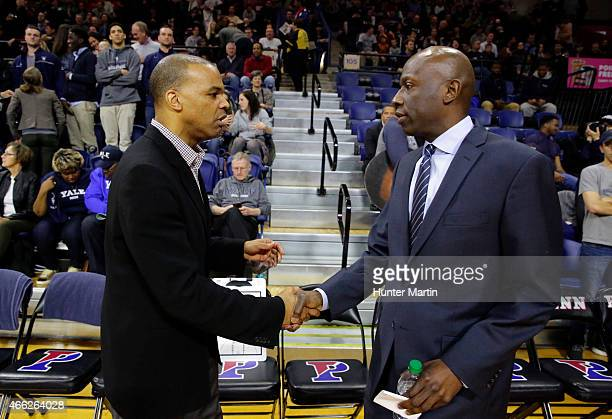 Head coach Tommy Amaker of the Harvard Crimson shakes hands with head coach James Jones of the Yale Bulldogs before a game at the Palestra on the...