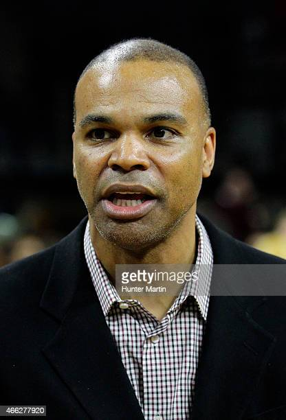 Head coach Tommy Amaker of the Harvard Crimson stands on the court after winning a game against the Yale Bulldogs at the Palestra on the campus of...