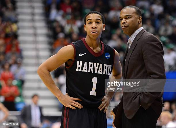 Head coach Tommy Amaker of the Harvard Crimson talks with Siyani Chambers in the first half against the New Mexico Lobos during the second round of...