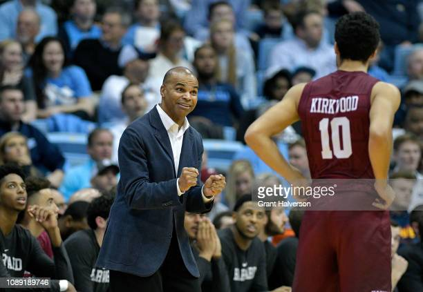 Head coach Tommy Amaker talks with Noah Kirkwood of the Harvard Crimson during the second half of their game against the North Carolina Tar Heels at...