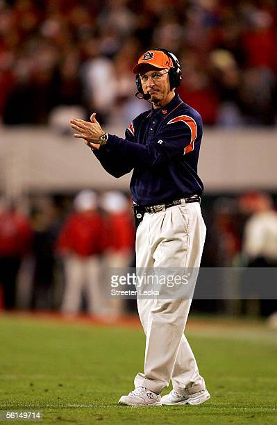 Head coach Tommy Tuberville of the Auburn Tigers calls a play against the Georgia Bulldogs during their game on November 12 2005 at Sanford Stadium...