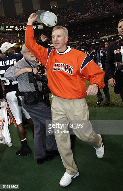 Head coach Tommy Tuberville of the Auburn Tigers celebrates after his team defeat the Virginia Tech Hokies by a score of 1613 during the Nokia Sugar...