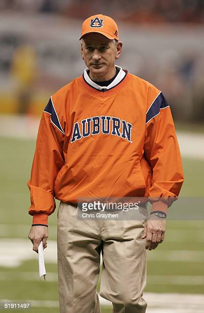 Head coach Tommy Tuberville of the Auburn Tigers walks off the field at halftime during a game against the Virginia Tech Hokies at the Nokia Sugar...