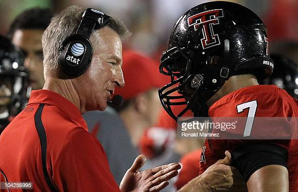 Head coach Tommy Tuberville of the Texas Tech Red Raiders talks with Will Ford during play against the Texas Longhorns at Jones AT&T Stadium on...