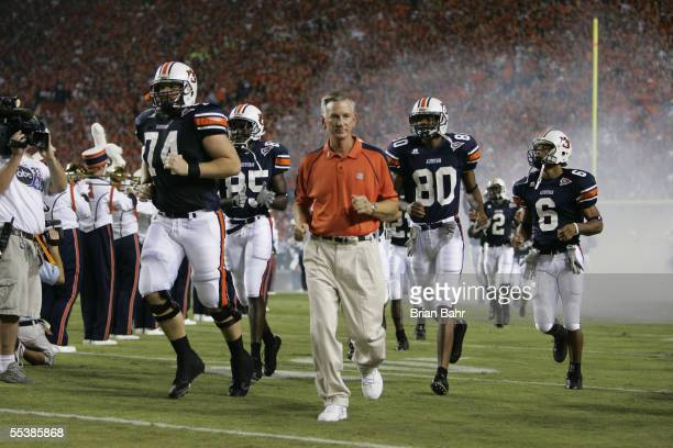 Head Coach Tommy Tuberville, Steven Ross and Matthew Motley of the Auburn Tigers enter the field for the game against the Georgia Tech Yellow Jackets...