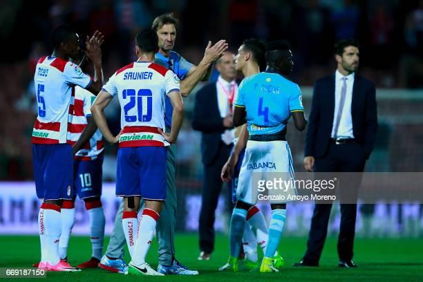 Head coach Tony Adams of Granada CF acknowledges the audience with his palyers after the La Liga match between Granada CF and Real Club Celta de Vigo...