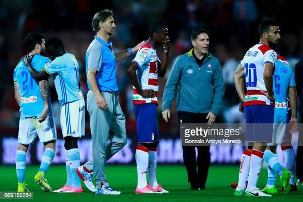 Head coach Tony Adams of Granada CF comforts his palyer as Uche Henry Agbo after the La Liga match between Granada CF and Real Club Celta de Vigo at...