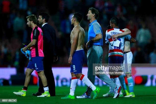 Head coach Tony Adams of Granada CF leaves the pithc with his player Ezequiel Ponce palyers after the La Liga match between Granada CF and Real Club...