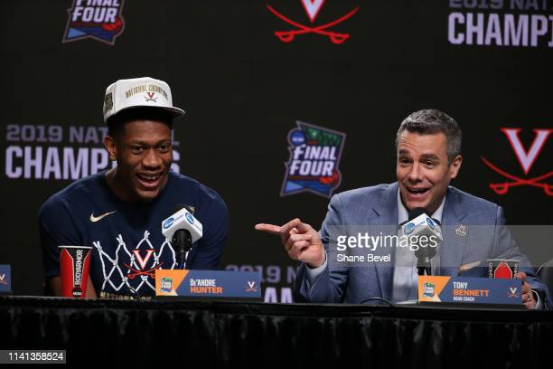 Head coach Tony Bennett and De'Andre Hunter of the Virginia Cavaliers are interviewed during the press conference after the 2019 NCAA Photos via...