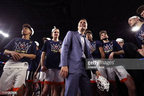 Head coach Tony Bennett of the Virginia Cavaliers celebrates with his team after the 8577 win over the Texas Tech Red Raiders in the 2019 NCAA men's...