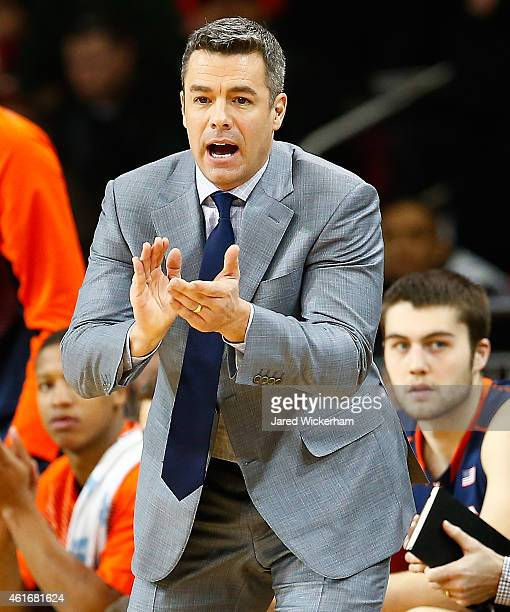 Head coach Tony Bennett of the Virginia Cavaliers cheers on his team from the bench in the first half against the Boston College Eagles during the...