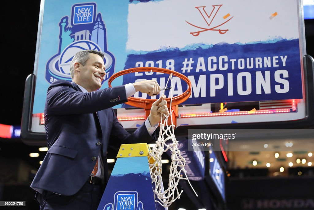 Head coach Tony Bennett of the Virginia Cavaliers cuts down the net after defeating the North Carolina Tar Heels 71-63 during the championship game of the 2018 ACC Men's Basketball Tournament at Barclays Center on March 10, 2018 in the Brooklyn borough of New York City.