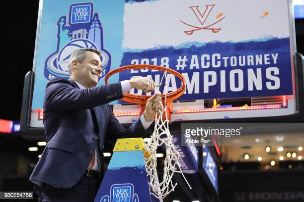 Head coach Tony Bennett of the Virginia Cavaliers cuts down the net after defeating the North Carolina Tar Heels 7163 during the championship game of...