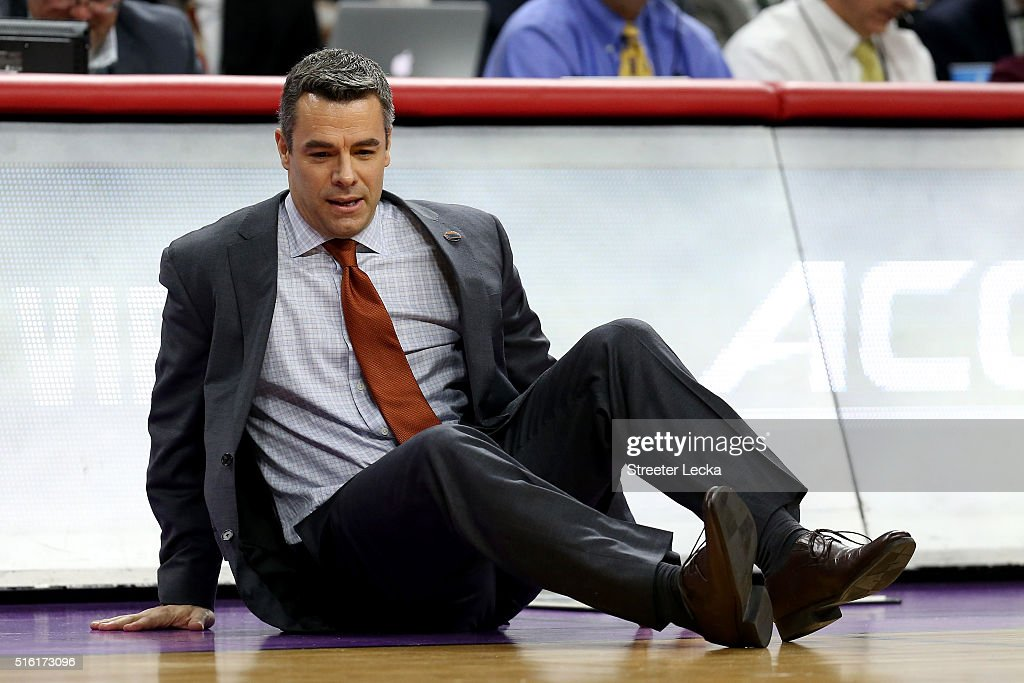 Head coach Tony Bennett of the Virginia Cavaliers falls to the court in the first half while taking on the Hampton Pirates in the first round of the 2016 NCAA Men's Basketball Tournament at PNC Arena on March 17, 2016 in Raleigh, North Carolina.