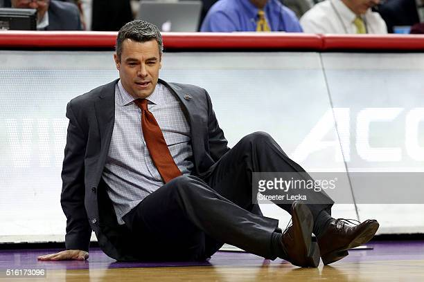 Head coach Tony Bennett of the Virginia Cavaliers falls to the court in the first half while taking on the Hampton Pirates in the first round of the...