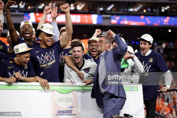 Head coach Tony Bennett of the Virginia Cavaliers places his teams name as National Champion on the bracket after his teams 8577 win over the Texas...