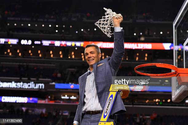 Head coach Tony Bennett of the Virginia Cavaliers raises the net after defeating the Texas Tech Red Raiders in the 2019 NCAA Photos via Getty Images...