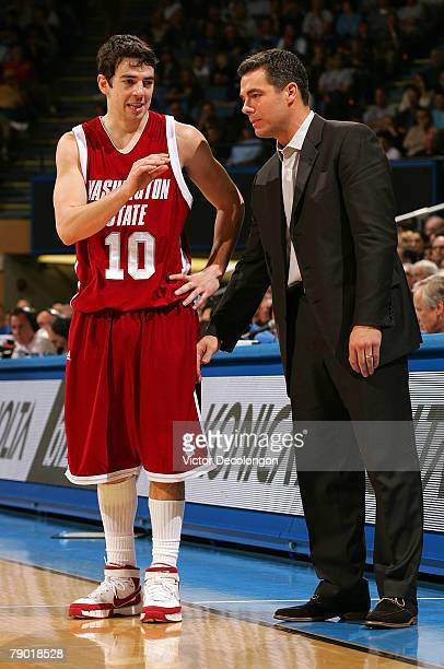 Head Coach Tony Bennett of the Washington State University Cougars listens to Taylor Rochestie during a break in NCAA Pac10 game action in the second...