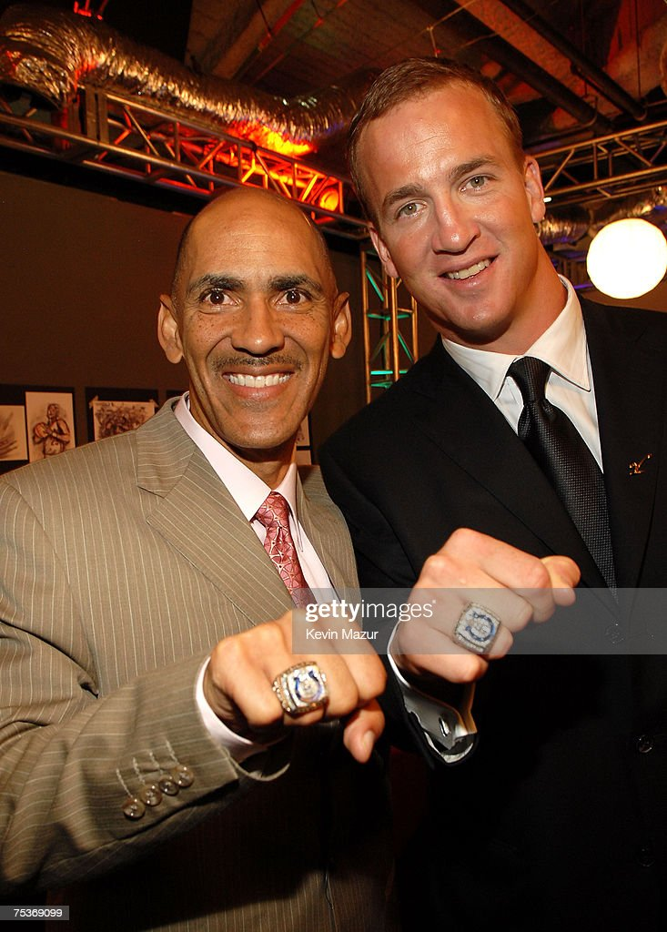 NFL head coach Tony Dungy and NFL quarterback Peyton Manning show off their Super Bowl rings backstage at the 2007 ESPY Awards at the Kodak Theatre on July 11, 2007 in Hollywood, California.
