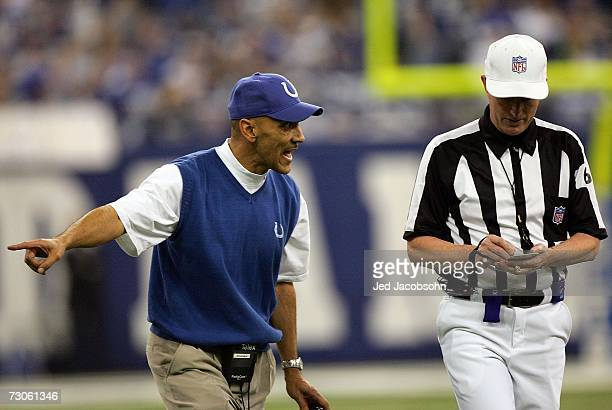 Head coach Tony Dungy of the Indianapolis Colts argues a call with the referee Bill Carollo during the AFC Championship Game against the New England...