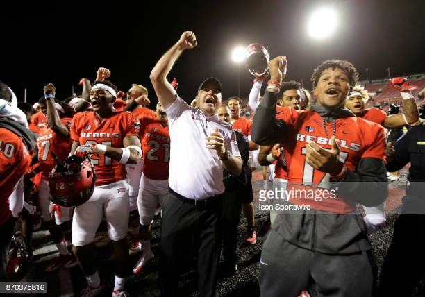 UNLV head coach Tony Sanchez and players celebrate after winning a game against Hawaii on November 04 at Sam Boyd Stadium in Las Vegas Nevada The...