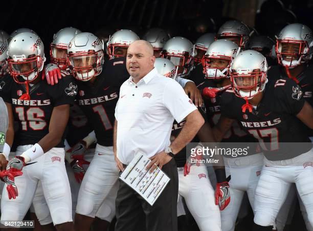 Head coach Tony Sanchez of the UNLV Rebels prepares to take the field with his players before their game against the Howard Bison at Sam Boyd Stadium...